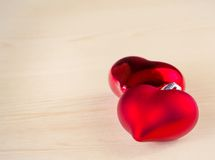 Two red hearts isolated on wood background, concept of valentine day Royalty Free Stock Image