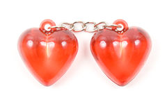 Two red hearts joined by a chain Stock Photos