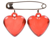 Two red hearts are joined with a pin Royalty Free Stock Photo
