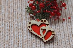 Two red hearts made of wood on a woolen knit background Stock Photos