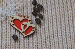Two red hearts made of wood on a woolen knit background Stock Photography