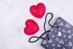 Two red hearts near the package. Hearts rolled out of the package. Hearts as a gift to each other royalty free stock photos