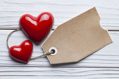 Two red hearts and one paper tag Royalty Free Stock Photos