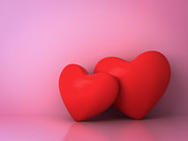 Two red hearts on pink background with reflection and shadow for valentines day background Stock Photography