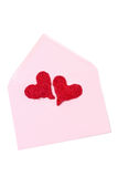 Two red hearts in a pink envelope, isolated Royalty Free Stock Photography