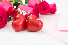 Two red hearts with pink envelope and red roses Royalty Free Stock Image