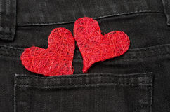 Two red hearts in a pocket Royalty Free Stock Image