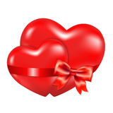 Two Red Hearts With Red Bow Royalty Free Stock Images