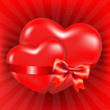 Two Red Hearts With Red Bow And Sunburst Stock Image