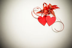 Two red hearts and ribbon Royalty Free Stock Image