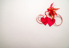 Two red hearts and ribbon Royalty Free Stock Photo