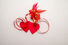 Two red hearts and ribbon Royalty Free Stock Photography