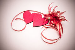 Two red hearts and ribbon Stock Photo