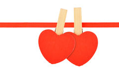 Two red hearts at ribbon  on white Stock Images