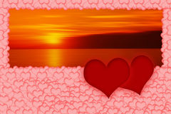 Two red hearts on romantic blurred sunset background. Two red hearts are placed on a multitude of pink hearts in the bottom of the image. All on romantic blurred royalty free illustration