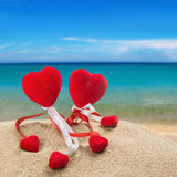 Two red hearts in the sand on the ocean background Royalty Free Stock Photography