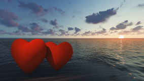 Two red hearts in the sea at sunset. Concept of love and Valentine`s Day stock video footage