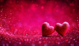 Two Red Hearts In Shiny Background royalty free stock photos