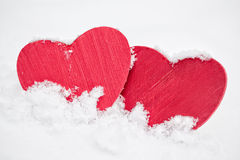 Two red hearts in snow Stock Photo