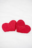 Two red hearts in snow. Two red painted wooden hearts covered in real fresh snow in winter for Valentines Day Stock Photo