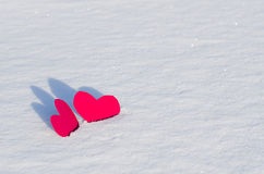 Two red hearts in  snow. On sunlight Stock Image
