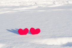 Two red hearts in  snow Royalty Free Stock Photos