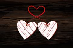 Two red hearts on a stick with bow and ribbon. Valentine`s Day. Vector illustration. Greeting card with empty space for the text or advertising. On wooden Stock Images