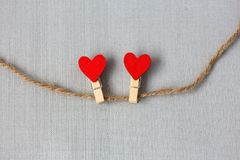 Two hearts on a string as a symbol of love. Two red hearts on a string as a symbol of love Stock Image
