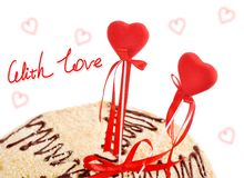 Two red hearts in a target of cake Stock Photography