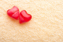 Two red hearts on terry towel Royalty Free Stock Photography