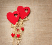 Two red hearts on textile Stock Photo