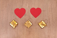 Two red hearts and three gift box Royalty Free Stock Image