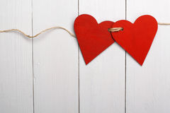 Two red hearts tied together Stock Images