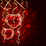Two red hearts and tinsel Stock Photography