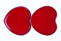 Two red hearts together Royalty Free Stock Photography