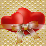 Two red hearts with transparent ribbon Stock Images