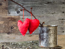 Two Red Hearts twig board rusty tin royalty free stock photography