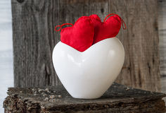 Two Red Hearts twig board white cup Royalty Free Stock Images