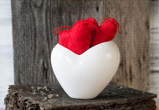 Two red hearts twig board white cup Royalty Free Stock Photo