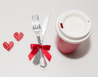 Two red hearts and two white cups for Valentines Day. Two red hearts and two white cups with white background Royalty Free Stock Photos