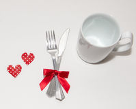 Two red hearts and two white cups for Valentines Day. Two red hearts and two white cups with white background Stock Image