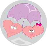 Two red hearts under umbrella Royalty Free Stock Photo