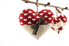 Two red hearts with white and brown bows on branch on white background Royalty Free Stock Photo