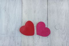 Two red hearts on white wooden background. With copy space Stock Images