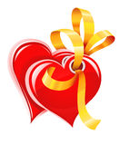 Two Red Hearts With Gold Ribbon Isolated Stock Photo