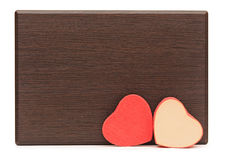 Two red hearts on wood Royalty Free Stock Photo