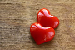 Two red hearts on wooden Royalty Free Stock Images