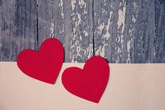 Two red hearts. On a wooden background Stock Photography