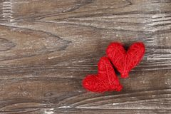 Two Red hearts on wooden background. Two Red hearts on old wooden background royalty free stock photography