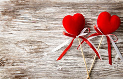 Two red hearts on wooden background. Valentines Day card. stock image